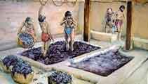 En Roma, un grupo de esclavos pisando la uva